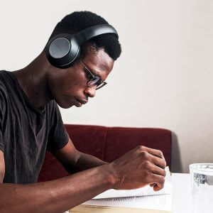 student wearing headphones and studying
